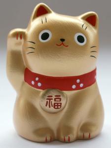 kucing melambai